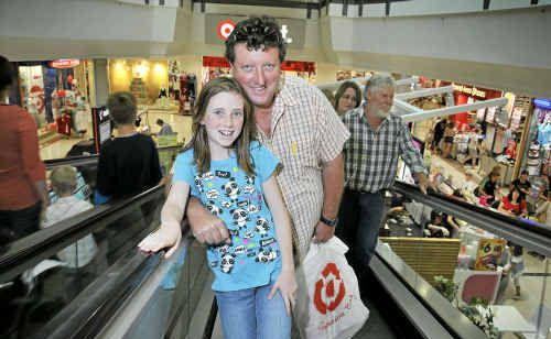 Cal and Stephanie McIntosh take on the Christmas crowds to complete their shopping list.