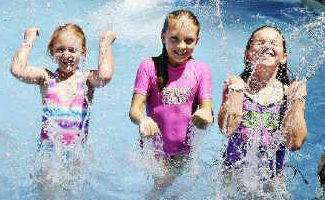 Splashdown: Edyn, 7, Indiah, 10, and Keeley, 9, Linklater, from Brisbane enjoy a fun day out at Ballina waterslide while holidaying with their grandparents.