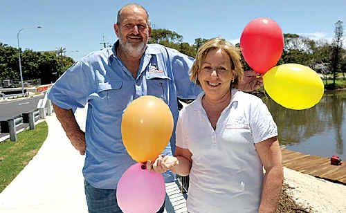 Bakery owner Bruce Rose and Louise Ferguson celebrate the new Tooway Bridge.