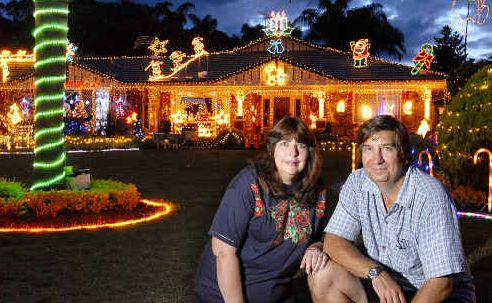 Debbie and Geoff Morris with their winning light display at 13 Mavis Court, Highfields.
