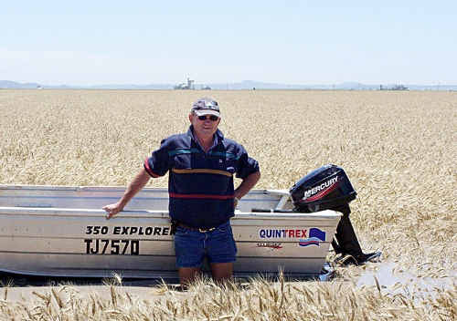 Cecil Plains farmer Graham Clapham had to resort to using a boat to get across his wheat crops after heavy rains in the region at the weekend.