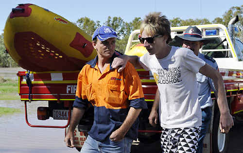 Rescued teenager Matt McKay (right) gets some support from his father Allen McKay after being stranded.