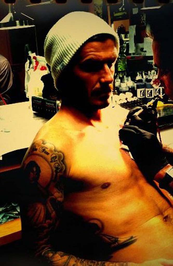 David Beckham used Facebook to show fans a photo of him getting a new tattoo.