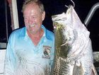 Denis Harrold with a pending world record barramundi caught at Lake Monduran.