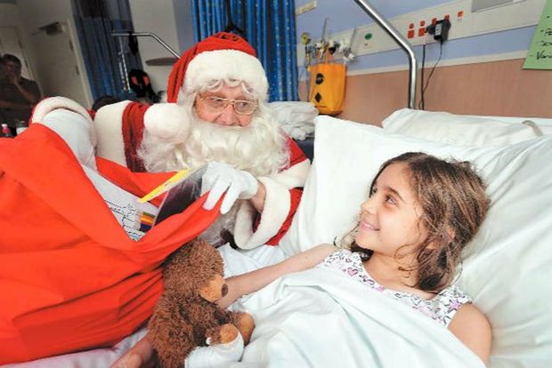 Renee Rovere catches up with Santa at Coffs Harbour Base Hospital children's ward.