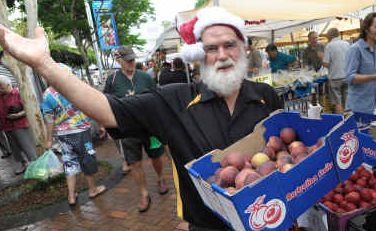 Happy healthy Christmas: Farmer Tom at a bustling city market in the countdown to Christmas.