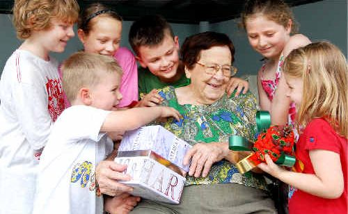 Matriach Beatrice Bagley enjoys a chuckle in the lead-up to Christmas with some of her great-grandchildren, from left, Tim Berardi, Charles Hall, Josie Berardi, Harry Hall, Megan Fredrickson and Eden Bagley.