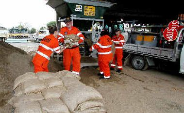 SES crew members, from left, Kirsty Moloney, Barry Jenkins, Benita Butler and Sarah Poole are busy filling 200 sand bags for the wet season at the Ness Street depot in preparation for forecast wet weather.