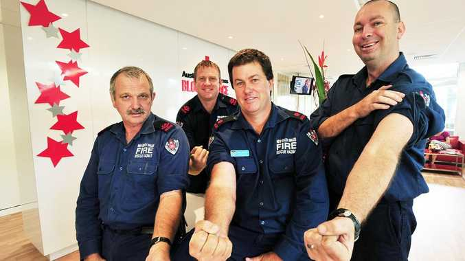 Woolgoolga Fire Station members (front, from left) Gary Howard, Drew Armitage and Lee Varney and (at back) Chris Barnes at the blood donor centre.