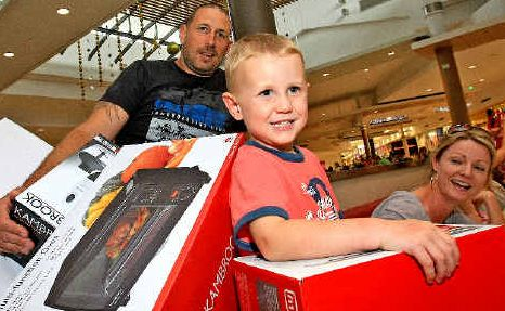 Shopping smiles: Paul Willis, Kyan Willis and Shea Cameron with their Boxing Day haul.