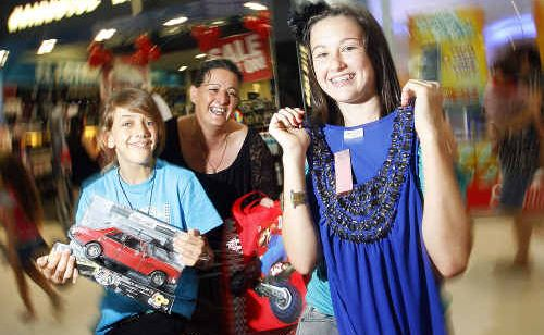Leisa Randolph and her daughters Brittany, 10, and Mikayla, 13, show off their Boxing Day sales purchases at Riverlink Shopping Centre.