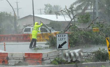 This was the scene on Harbour Road on Christmas Day as emergency crews worked to repair fallen powerlines and restore electricity to hundreds of properties after a mini tornado struck.