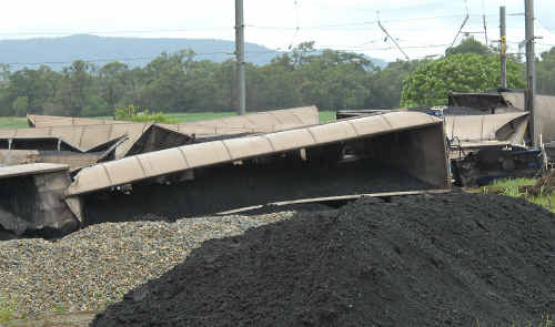 A tangled pile of coal carriages blocks rail lines at Yukan, south of Sarina, following a derailment on Christmas Day.