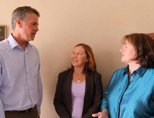 Valla parents Jan Gill, centre, and Christabel Wright talk to shadow Roads Minister Andrew Stoner.