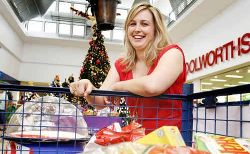 Booval Fair shopping centre marketing manager Kelly Beaverson with some of the Foodbank items donated in collection bins outside Woolworths.