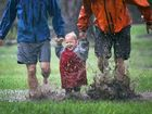 Shanti Vogel, aged 17 months, pictured with mum Liv and dad Andre, having fun in rain.