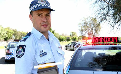 Senior Constable Dominic Savoia with a breathalyser that is used to read a person's blood alcohol level. Police hope mandatory alcohol interlocks will help curb the number of drink-drivers on the region's roads.