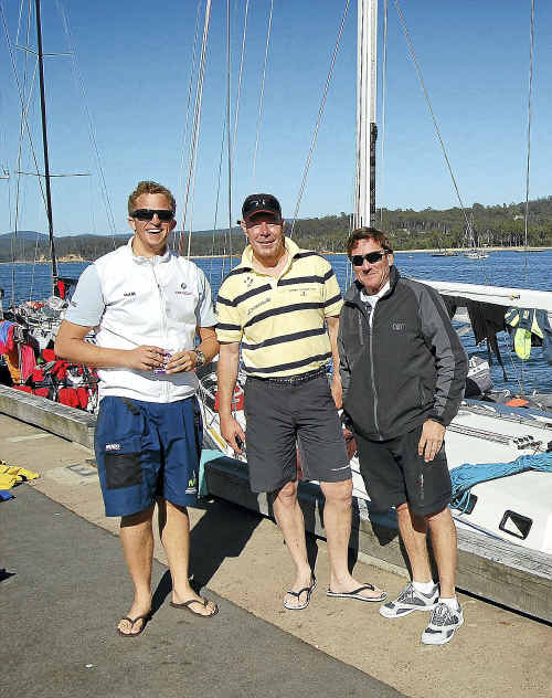RACE PLAN: Brindabella crew members Charles Kosecki, Tim Colclough and Stuart Ford wait dockside at Eden and ponder a late entry in The Pittwater to Coffs Harbour Yacht Race.
