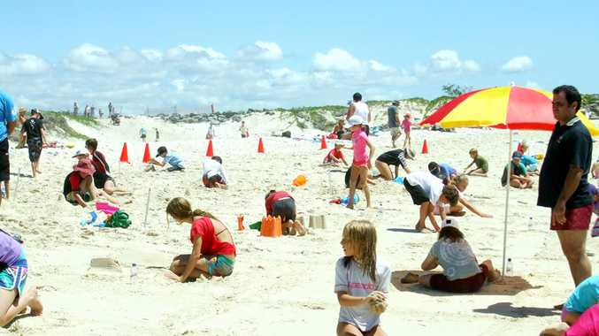 Sand modellers go to work on the beach at Brunswick Heads at last year's event.