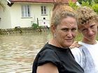 Kim and David Nilsen outside Kim's partially flooded home on Maryborough Street.