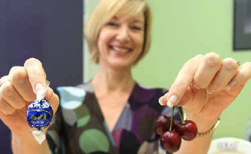 Healthy New Year: Amanda Clark urges us to savour treats, but opt for fruit snacks.