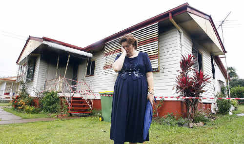 A distressed Karen Mayall stands outside her Hunter Street home, which was destroyed by fire early on Christmas Day.