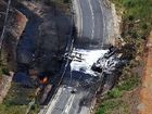 Inferno: The scorched section of the Pacific Highway, covered in foam, where a B-double fuel tanker careered out of control and burst into flames killing the driver and closing the highway in both directions.