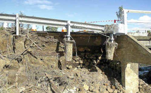 Flood damage at Palmer Bridge on Freestone Road.