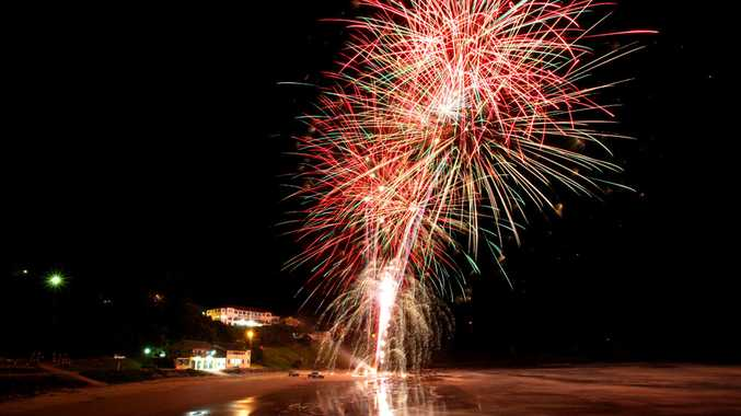 Fireworks explode over Main Beach Yamba as part of the Pacific Hotel's New Years fireworks. Photo: ADAM HOURIGAN/The Daily Examiner
