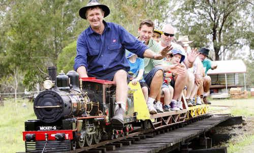 Vice-president Jeff Gillam takes passengers around the track.