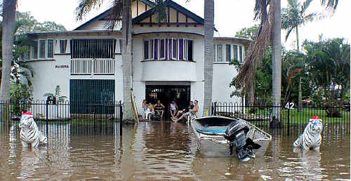 Jellicoe Street residents settle in for the duration as floodwaters rise steadily towards a peak on Wednesday.