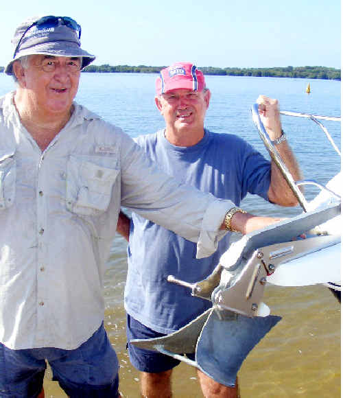 Big catch: Tom Manning (left) and Peter Harley with the small anchor that hooked an historic anchor now in the Ballina Naval and Maritime Museum.