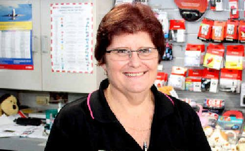 Heather Drew, who owns Finch Hatton Post Office, waded through shin-deep water to cross a bridge and get to work on Christmas Eve so people could receive their Christmas mail.