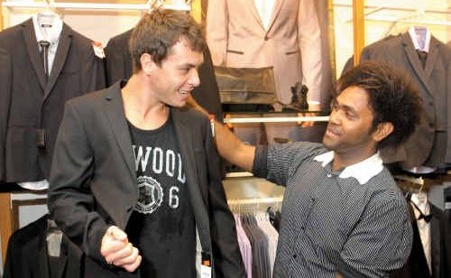 Trent Whitehead, left, of Mackay tries on a suit with help from Aden Billi at Roger David men's clothing store at Caneland Central yesterday.