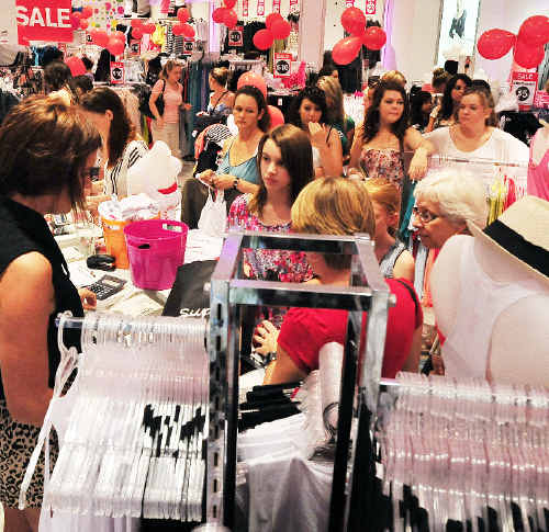 Shoppers scramble to get a bargain at Supre during the Boxing Day sales at Park Beach Plaza.