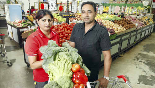 Devinder Singh with her brother-in-law Amarjit Singh at their family business Dinmore Fruit Barn.
