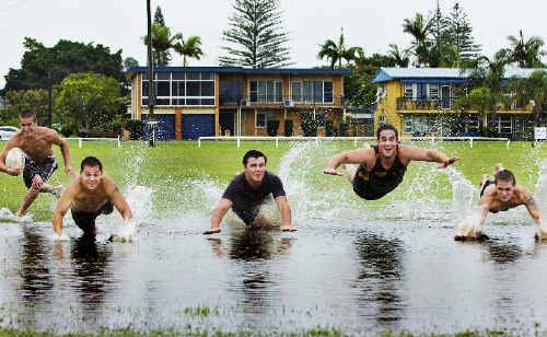 Jayden Flynn (left), Joel Roberts, Paul Turner, Jason Clarke and Nick Flynn, all from Ballina, enjoy the conditions in the town after recent heavy rainfall.