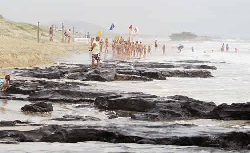The council is considering a rock wall on Maroochydore Beach after erosion has exposed coffee rock.