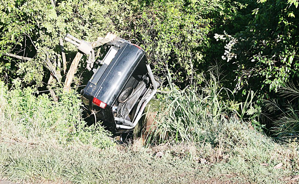 Two people were extremely lucky to escape from an accident which saw this vehicle leave the road at the entrance to Ailrie Beach on Shute Harbour Road on Tuesday morning.