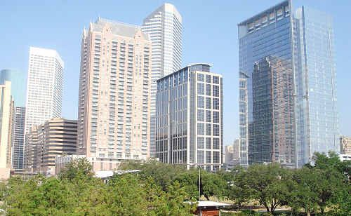 CITY VIEW: The sleek Houston skyline forms the dramatic backdrop for Discovery Green, nearly five hectares of spacious green lawns including a large lake, amphitheatre, children's playground, interactive water feature, and public art works.