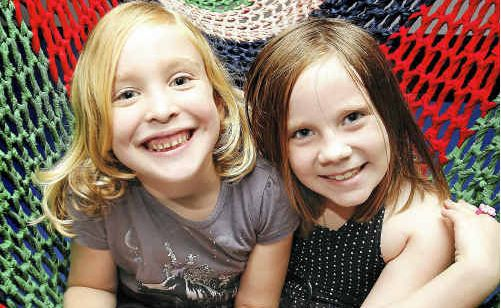 Cousins Heidi Parish (left), 6, and Bethany Garden, 6, at the Ipswich Art Gallery has fun activities for kids during the school holidays.