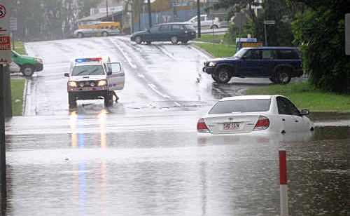 A Toyota Camry stranded after a family abandoned it while trying to cross Gympie's flooded Brisbane Road.