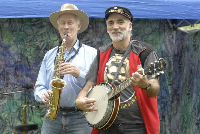 Mike Faunce-Brown (left) and Pat Menz as Kelly's Armour entertain the crowd at the Summer Tunes series.