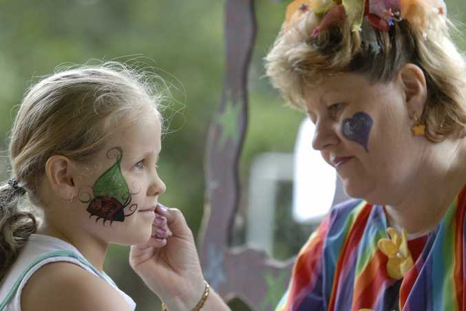 "Seven-year-old Brianna Byrde has her face painted by mum Katrina Byrde aka ""Sparkles""."