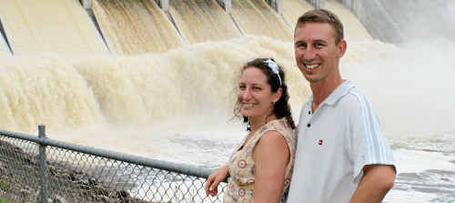 Jenny Seed and Ken McCray at Leslie Dam yesterday with water flowing from seven gates.