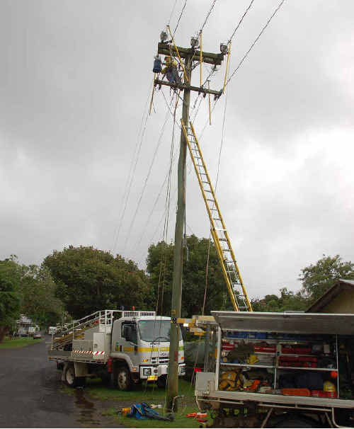 Great start to the week: A Country Energy crew on the corner of Lovell and South streets, Bellingen, working to restore supply to residents.