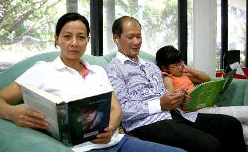 Huong Lam, Hanh Huynh and Thanh Huynh make good use of the Mackay City Library's facilities yesterday.