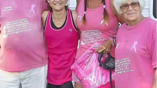 Ultra marathon runner Deborah de Williams (second right) and her parents/support crew Owen Drogemuller (left) and Karin Drogemuller (right), meet Mackay runner Janelle Tilse.