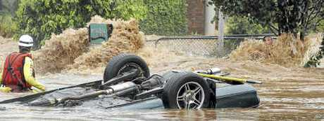 Edward Spark clings to life as he waits to be rescued from floodwaters in Dent Street.