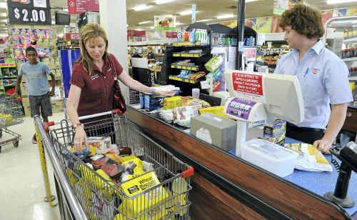 Rhonda Bauer stocks up at the IGA in Woongarra Street. Andrew Peever is behind the till.